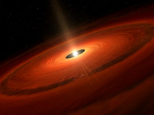 うみへび座TW星を取り巻く塵円盤の想像図 (国立天文台)